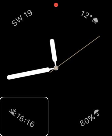 Tarcza Prosta, prezentująca komplikacje informujące użytkownika o południowo-zachodnim wietrze, wiejącym z prędkością 19 km/h, temperaturze 12 stopni, przelotnych opadach, i o godzinie zachodu słońca, przypadającej tego dnia na 16:16.