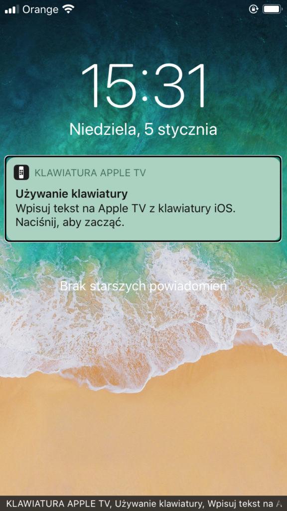 Zrzut ekranu iPhone z komunikatem o dostępnej Klawiaturze Apple TV wyświetlanym w Centrum Powiadomień