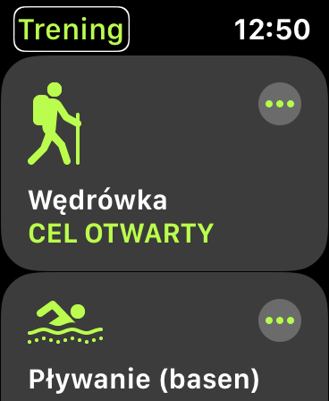 Zrzut ekranu z Apple Watch - Okno wyboru treningu. Na ekranie widoczne pozycje: Wędrówka - Cel otwarty oraz Pływanie, basen - Cel otwarty.